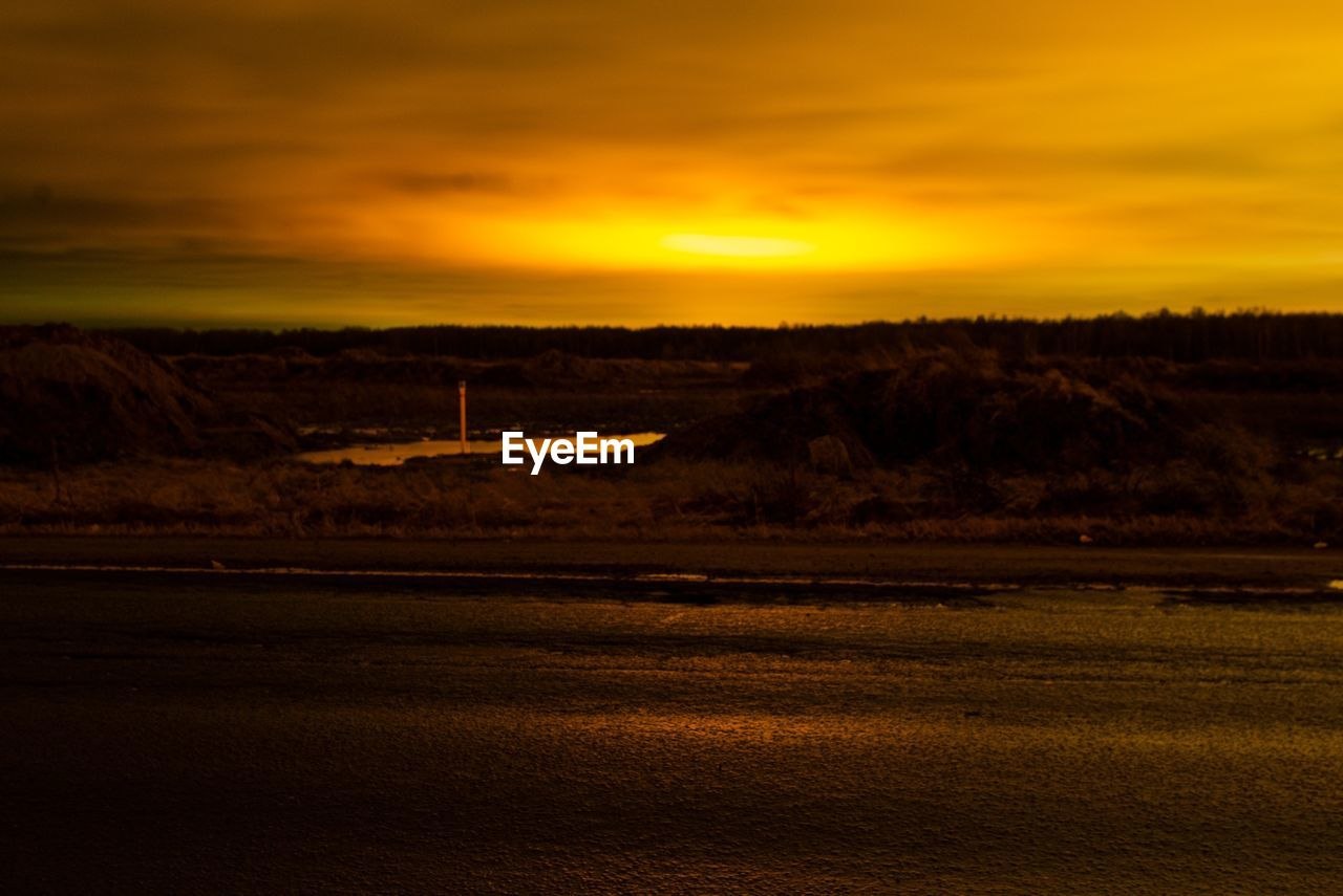 SCENIC VIEW OF DRAMATIC LANDSCAPE DURING SUNSET
