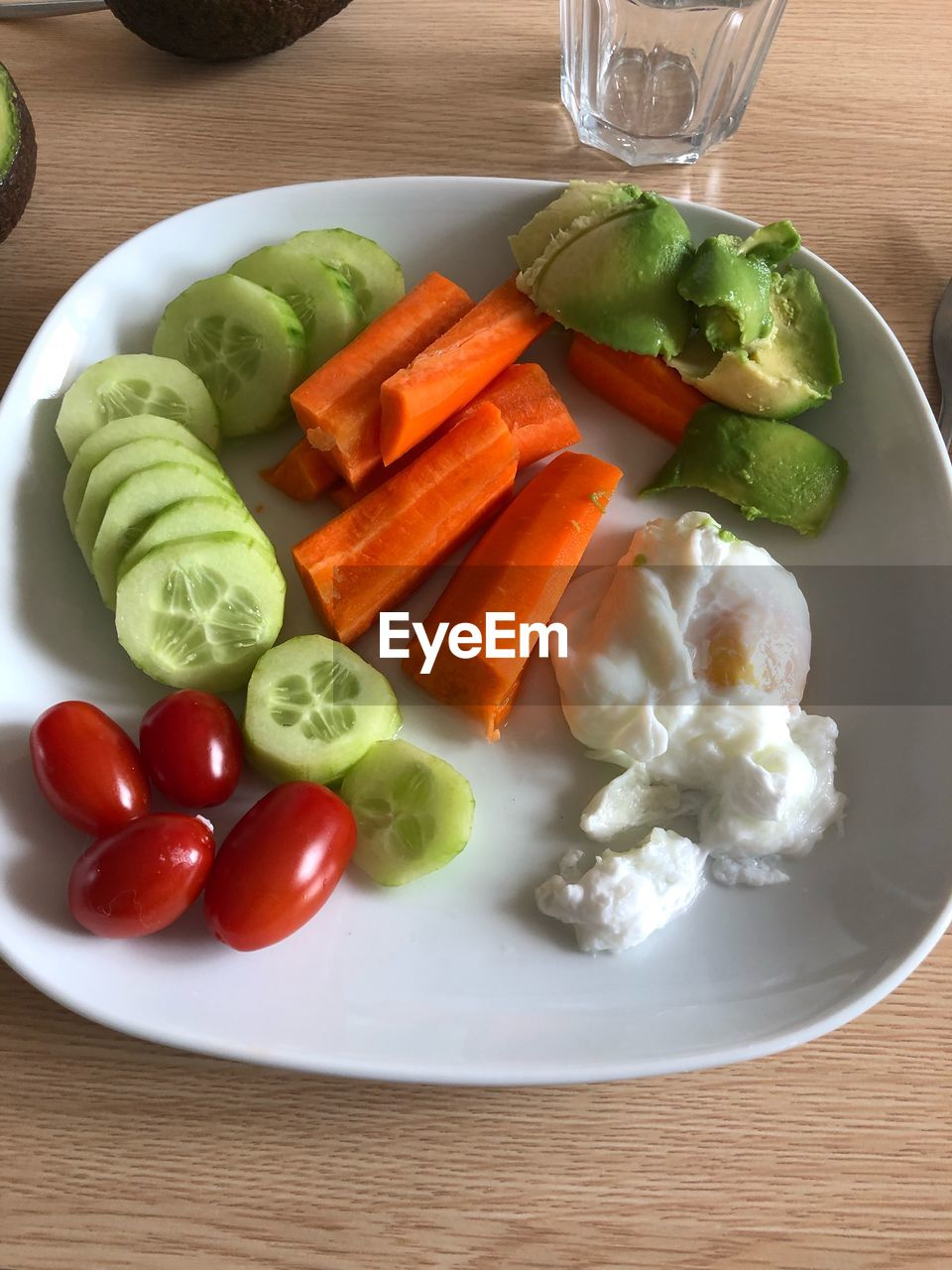 food and drink, food, freshness, healthy eating, table, plate, vegetable, ready-to-eat, wellbeing, indoors, fruit, still life, tomato, no people, cucumber, close-up, high angle view, carrot, salad, glass, chopped, vegetarian food, temptation