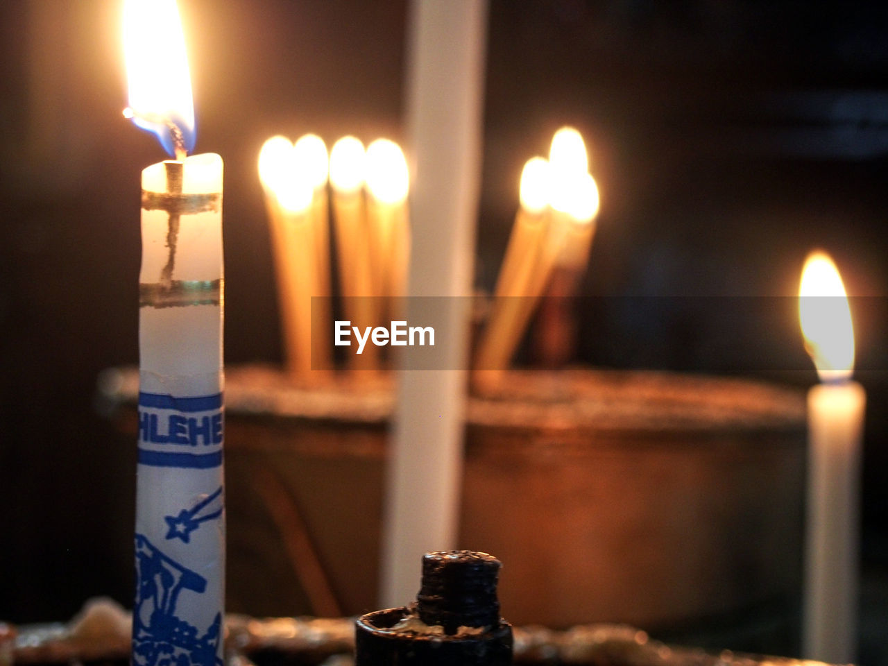 candle, flame, burning, glowing, illuminated, heat - temperature, focus on foreground, no people, close-up, indoors, day