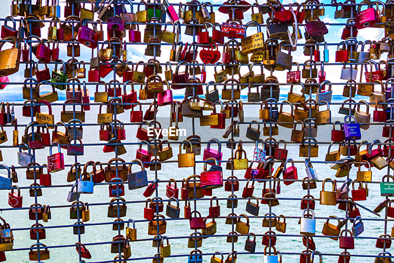 large group of objects, security, abundance, safety, protection, padlock, love, backgrounds, full frame, lock, positive emotion, hanging, love lock, no people, emotion, outdoors, multi colored, day, metal, railing