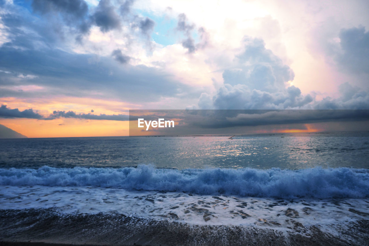sea, sky, water, cloud - sky, beauty in nature, scenics - nature, horizon over water, wave, horizon, motion, sunset, aquatic sport, beach, surfing, sport, nature, tranquility, tranquil scene, outdoors, power in nature