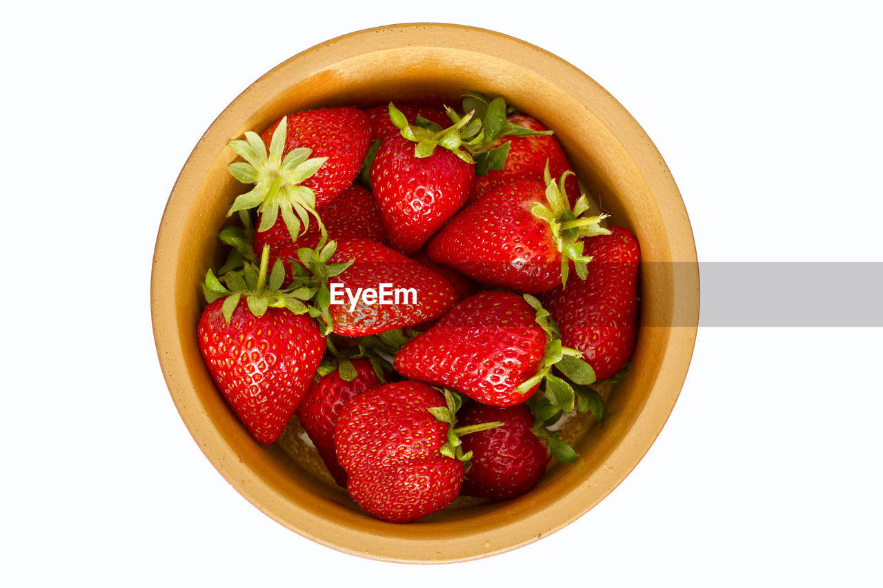 Directly Above Shot Of Strawberries In Bowl Over White Background