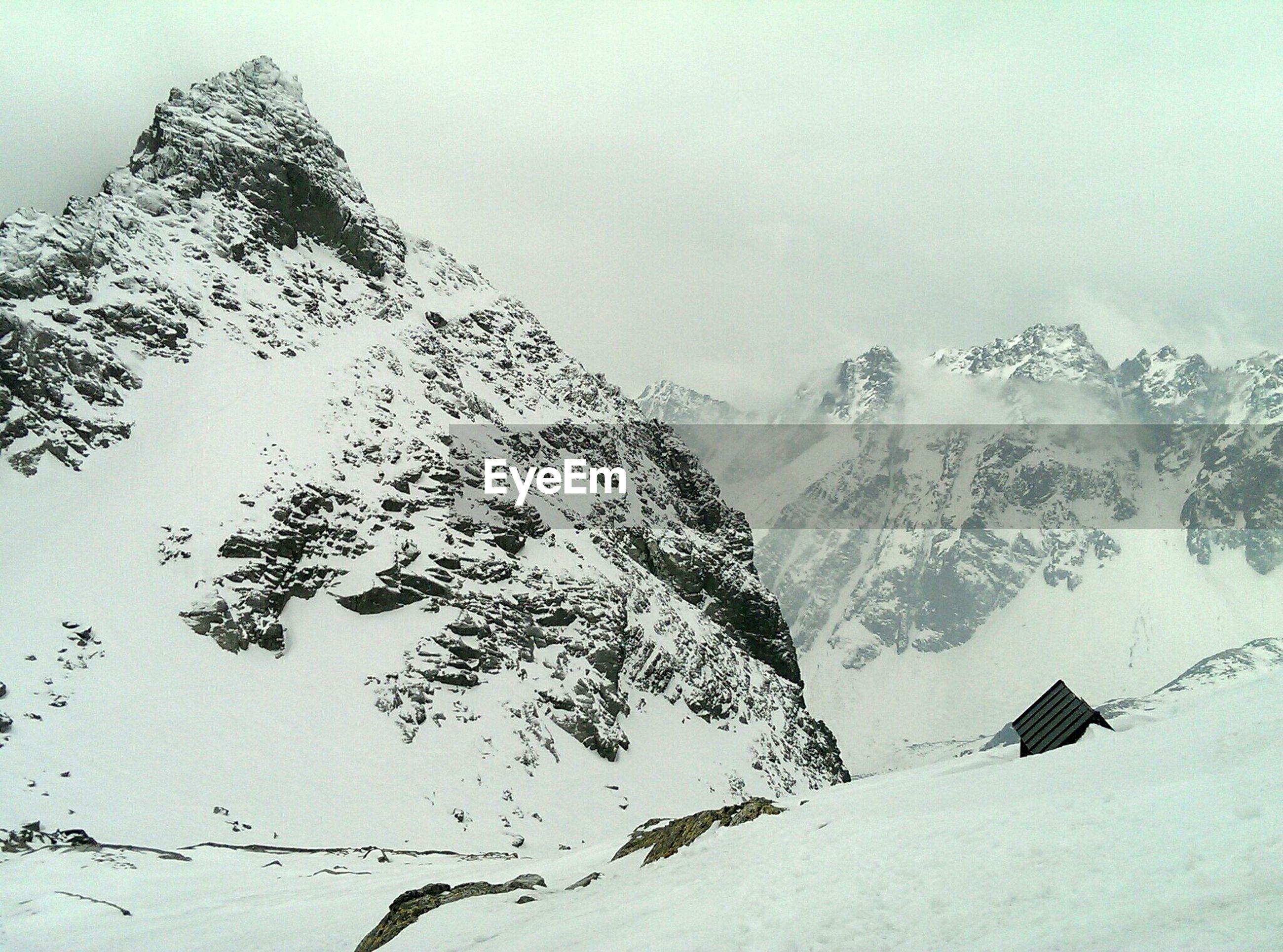 snow, winter, cold temperature, mountain, season, tranquility, tranquil scene, weather, mountain range, scenics, snowcapped mountain, beauty in nature, covering, nature, landscape, clear sky, non-urban scene, white color, snowcapped, sky
