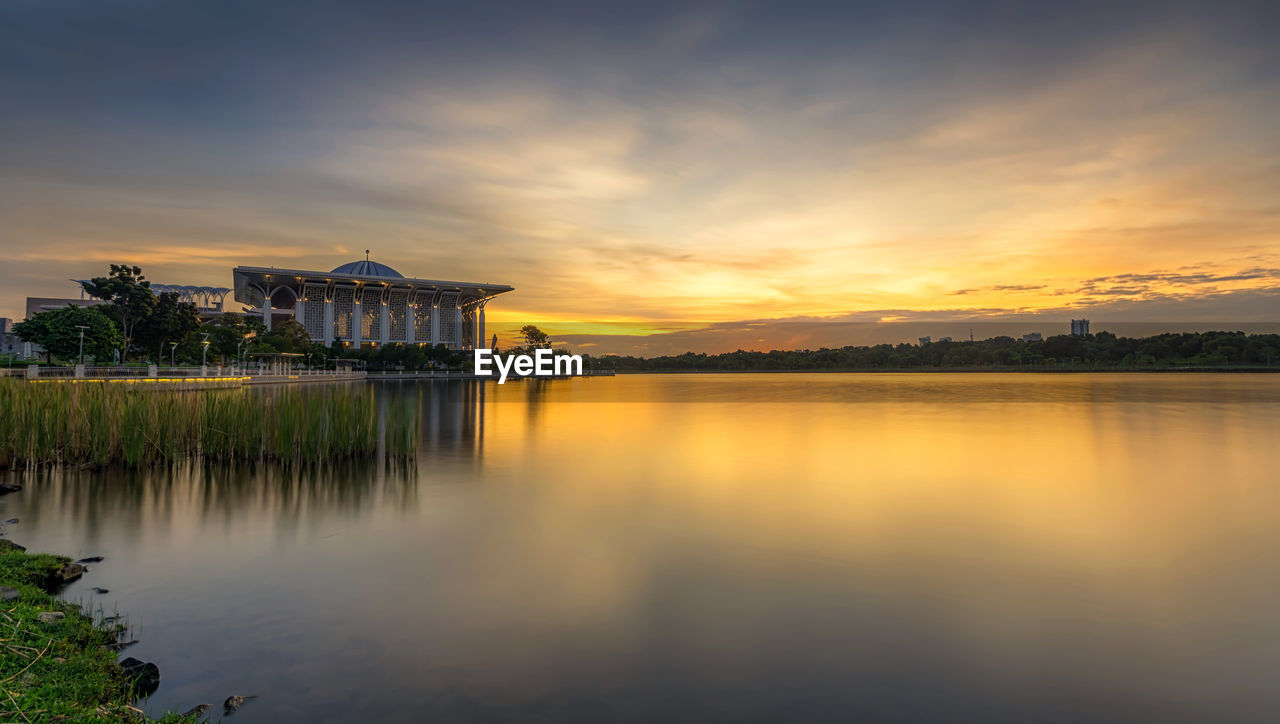 sky, water, architecture, built structure, sunset, cloud - sky, reflection, lake, building exterior, nature, belief, waterfront, religion, building, beauty in nature, place of worship, scenics - nature, tranquility, no people, shrine