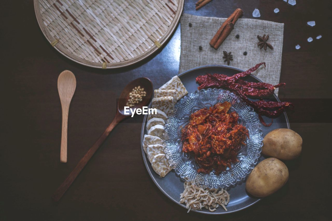 food, food and drink, kitchen utensil, freshness, directly above, indoors, table, high angle view, no people, wood - material, eating utensil, spoon, still life, healthy eating, wellbeing, ready-to-eat, household equipment, bowl, close-up, wooden spoon, dinner