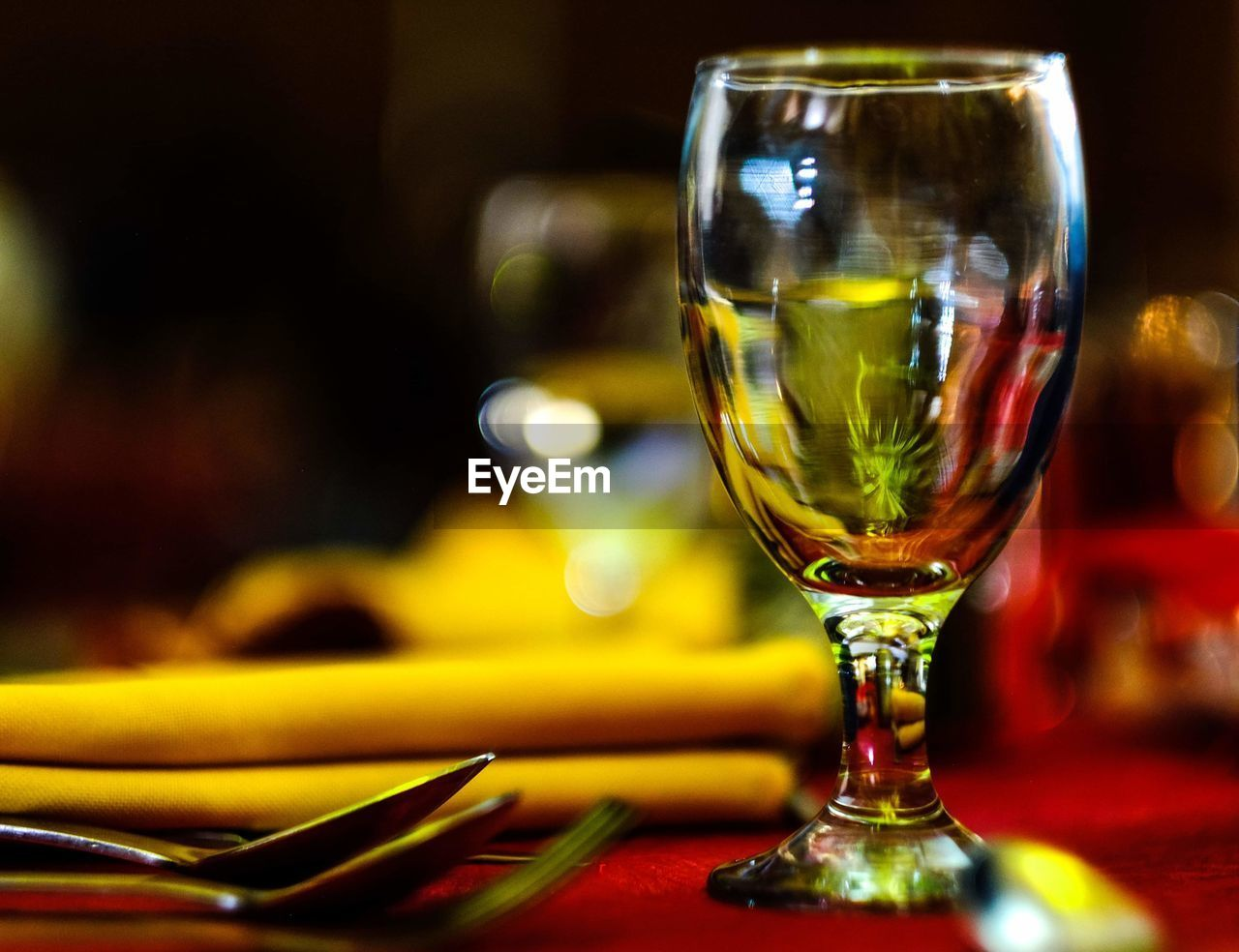 glass, refreshment, food and drink, focus on foreground, table, close-up, drinking glass, drink, household equipment, no people, glass - material, transparent, still life, indoors, wineglass, alcohol, freshness, selective focus, restaurant