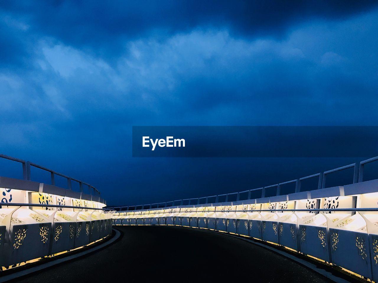 Bridge Over Road Against Sky At Dusk