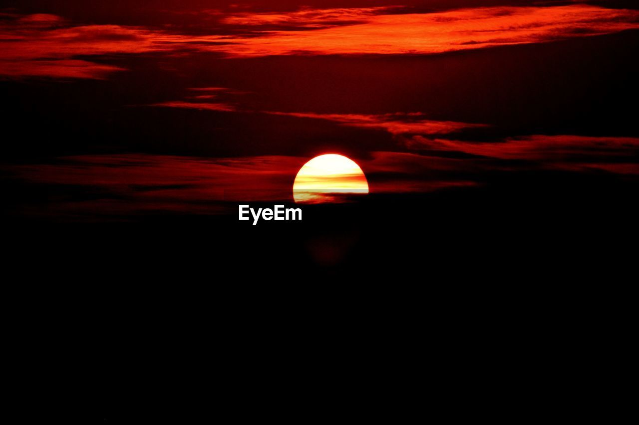 sky, scenics - nature, beauty in nature, sunset, cloud - sky, tranquil scene, tranquility, orange color, sun, idyllic, nature, no people, astronomy, space, silhouette, non-urban scene, outdoors, natural phenomenon, dark, copy space, eclipse