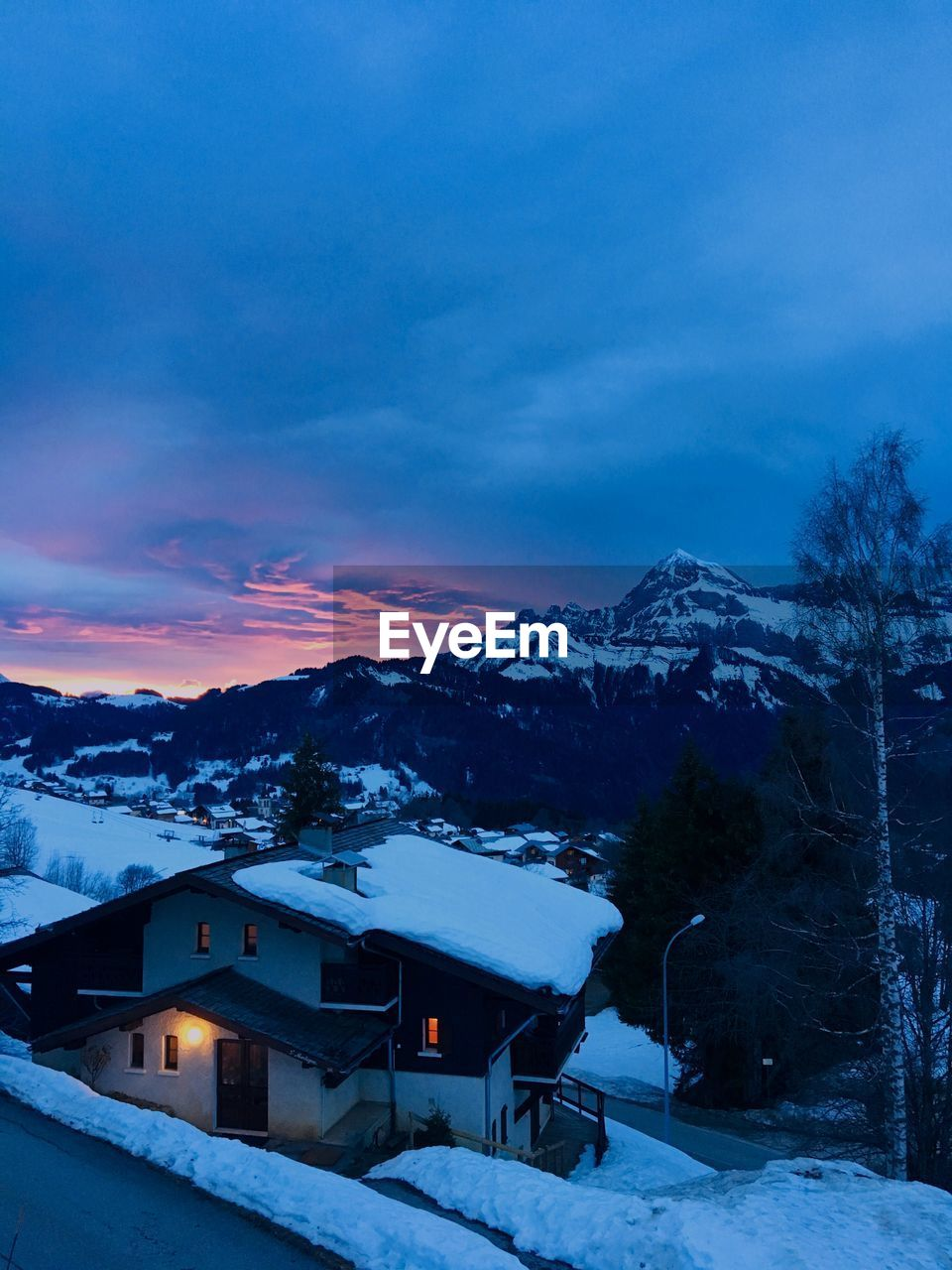 snow, winter, cold temperature, sky, architecture, built structure, mountain, beauty in nature, cloud - sky, building exterior, scenics - nature, house, building, nature, covering, sunset, tree, mountain range, snowcapped mountain, no people, outdoors, ski resort
