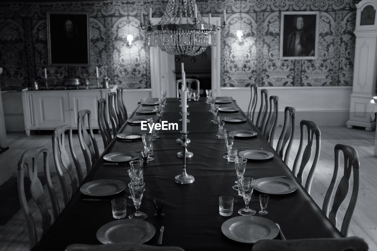 empty, in a row, table, indoors, chair, place setting, no people, absence, illuminated, neat, luxury, wineglass, day