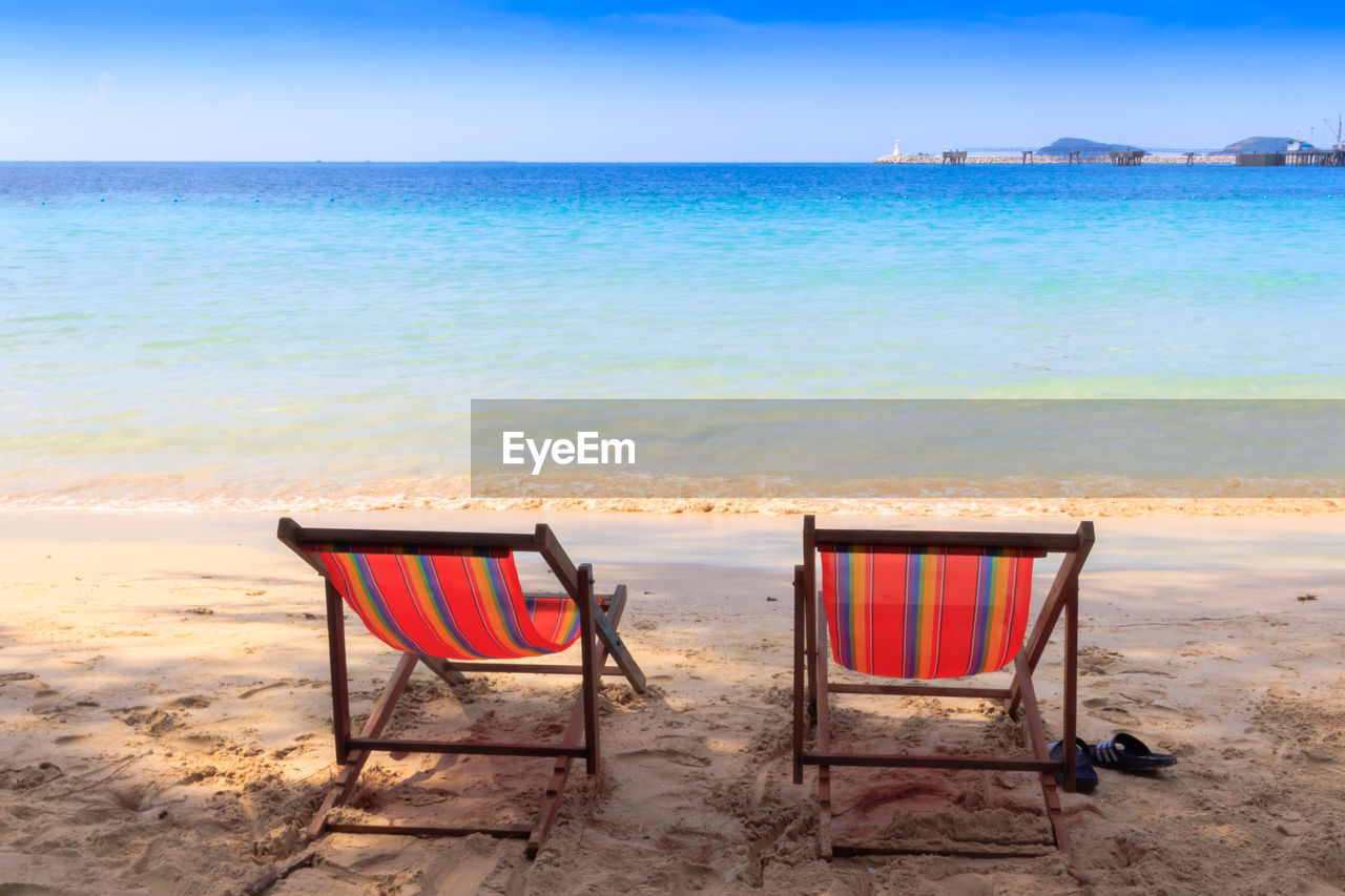 beach, sea, land, water, horizon over water, scenics - nature, beauty in nature, horizon, sky, chair, tranquil scene, sand, tranquility, nature, idyllic, seat, absence, relaxation, holiday, no people, outdoors