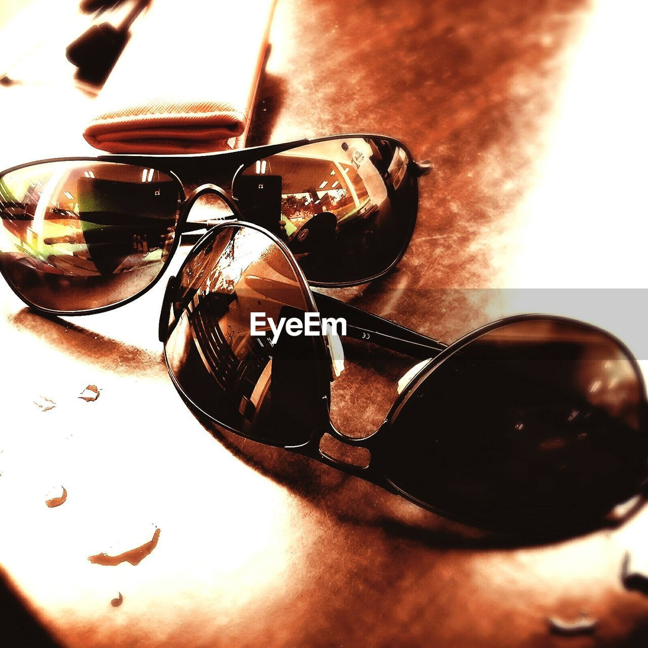 sunglasses, reflection, no people, table, close-up, indoors, day