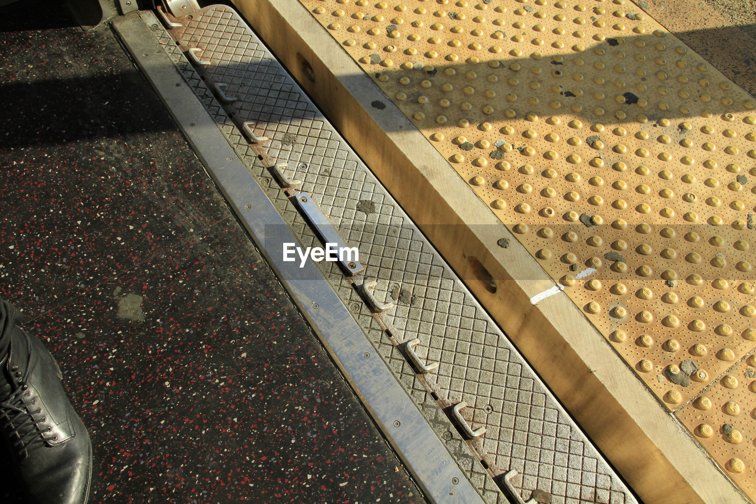 HIGH ANGLE VIEW OF ESCALATOR BY RAILROAD TRACKS