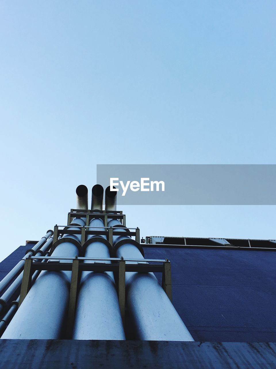 Low Angle View Of Pipelines Against Clear Sky