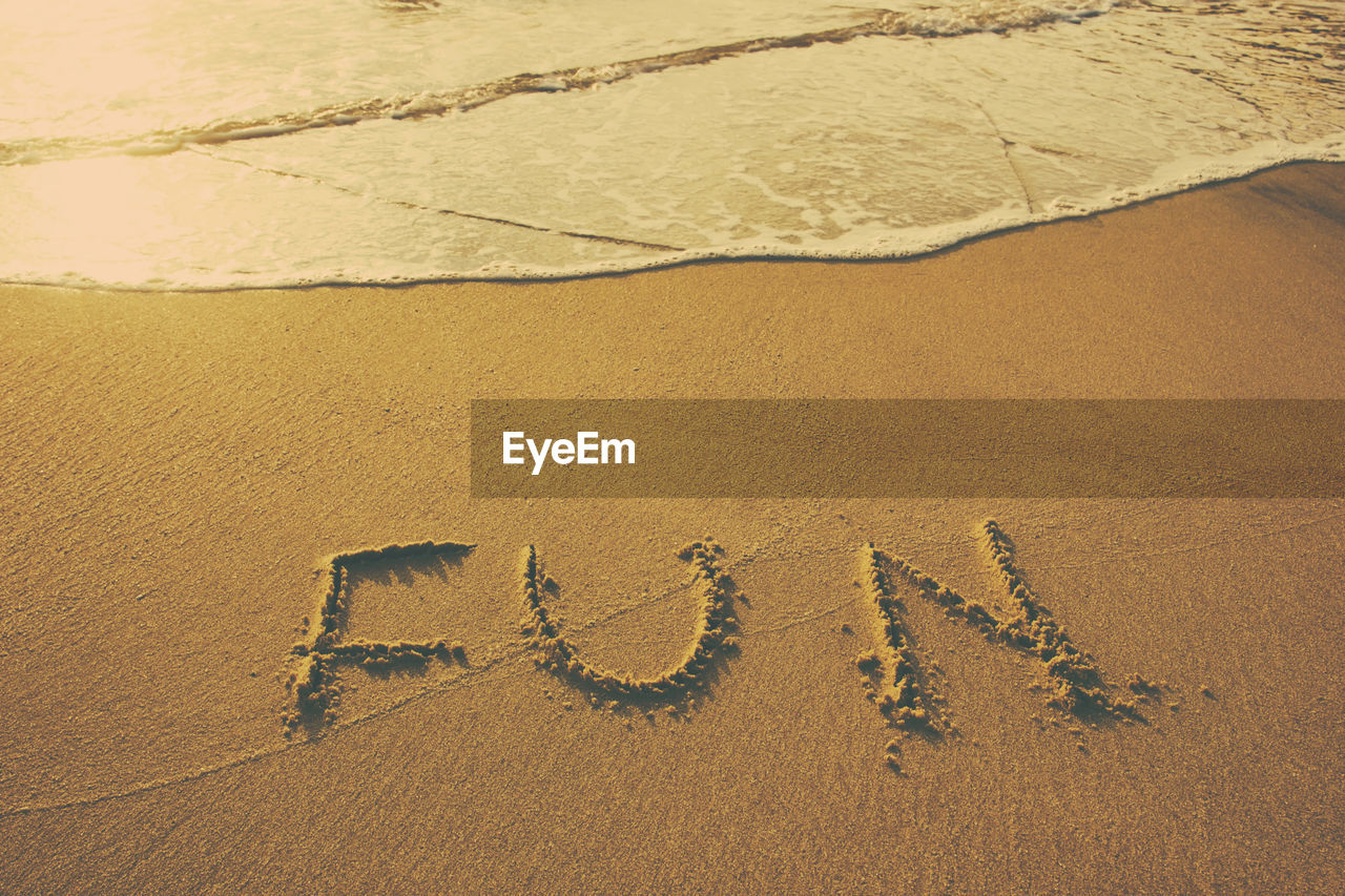 High Angle View Of Fun Text On Shore