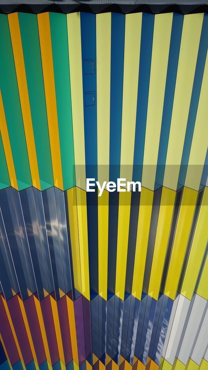 multi colored, yellow, pattern, striped, side by side, no people, backgrounds, full frame, repetition, day, in a row, large group of objects, close-up, blue, indoors, security, protection, variation, choice