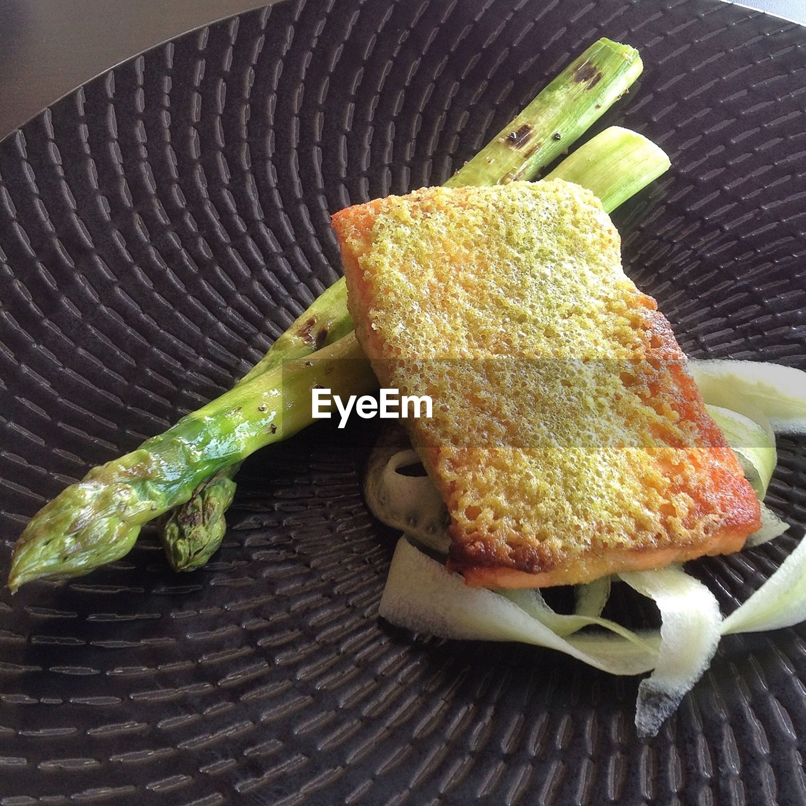 Dish with asparagus on plate