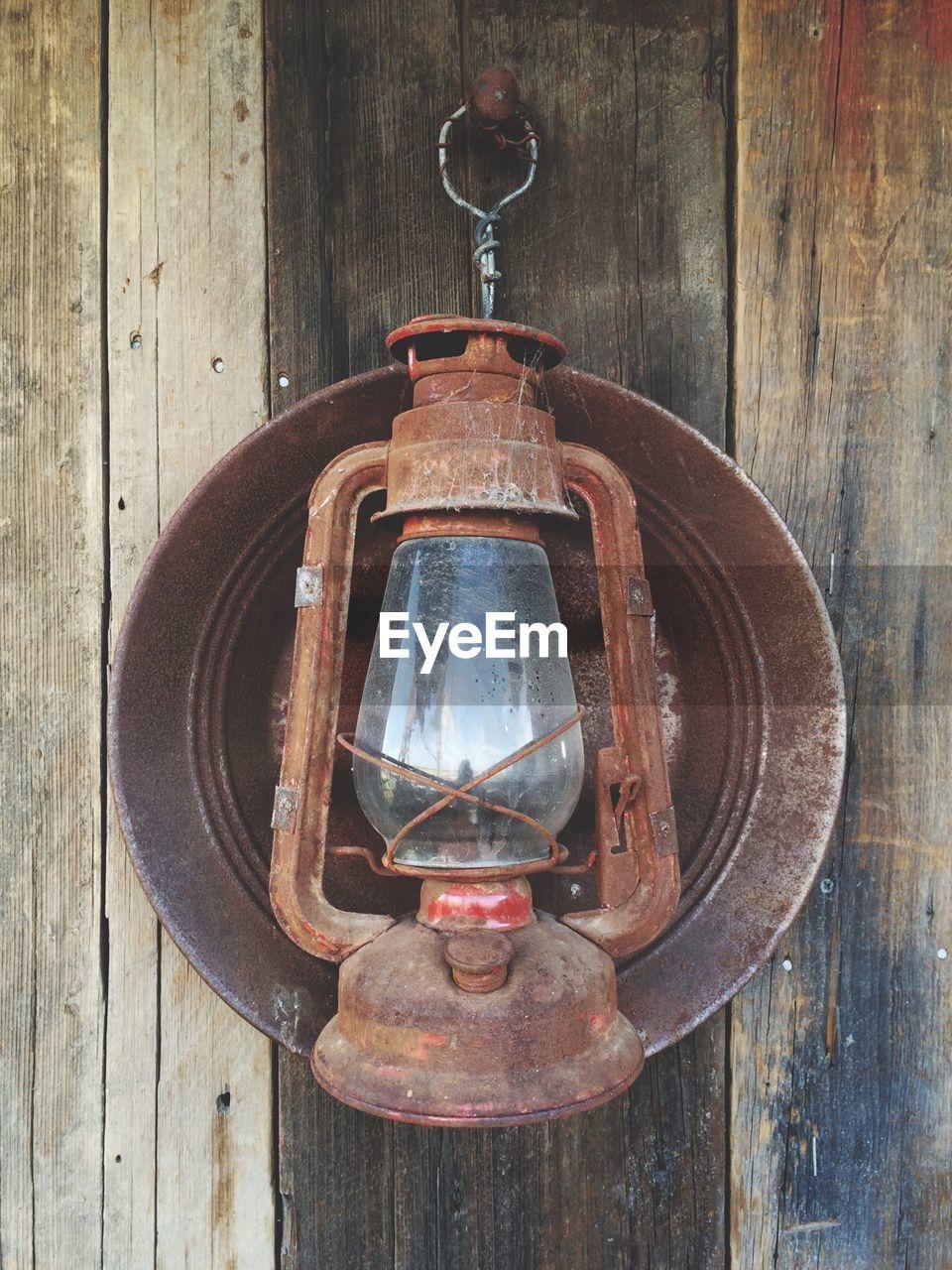 Old Rusty Metal Gas Light Lantern Hanging On Wood By Hook
