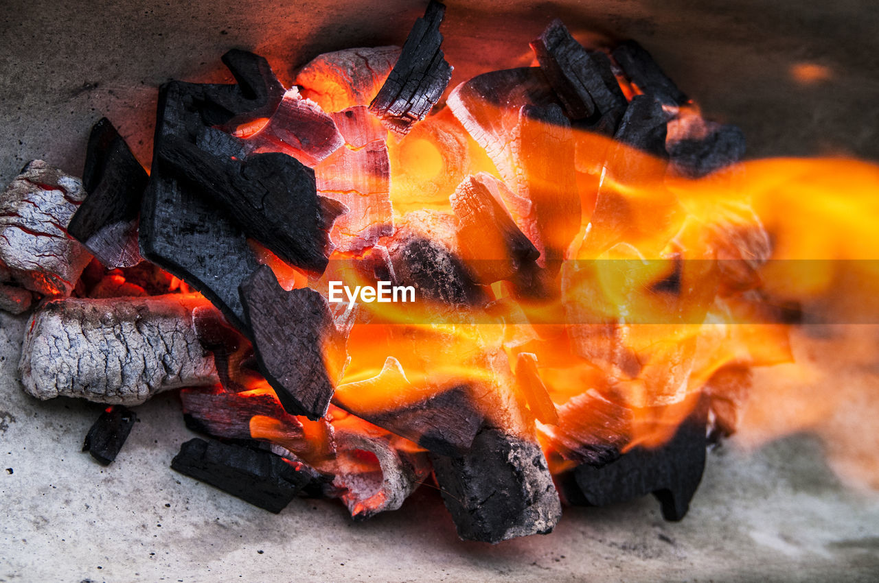 orange color, burning, heat - temperature, flame, coal, no people, outdoors, close-up, ash, day