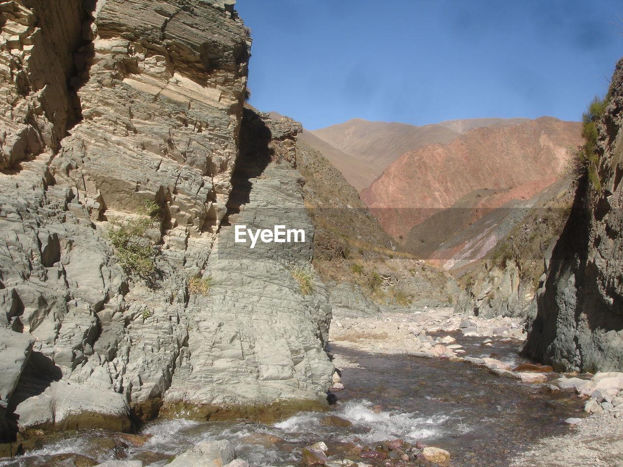 Narrow stream along rocky landscape
