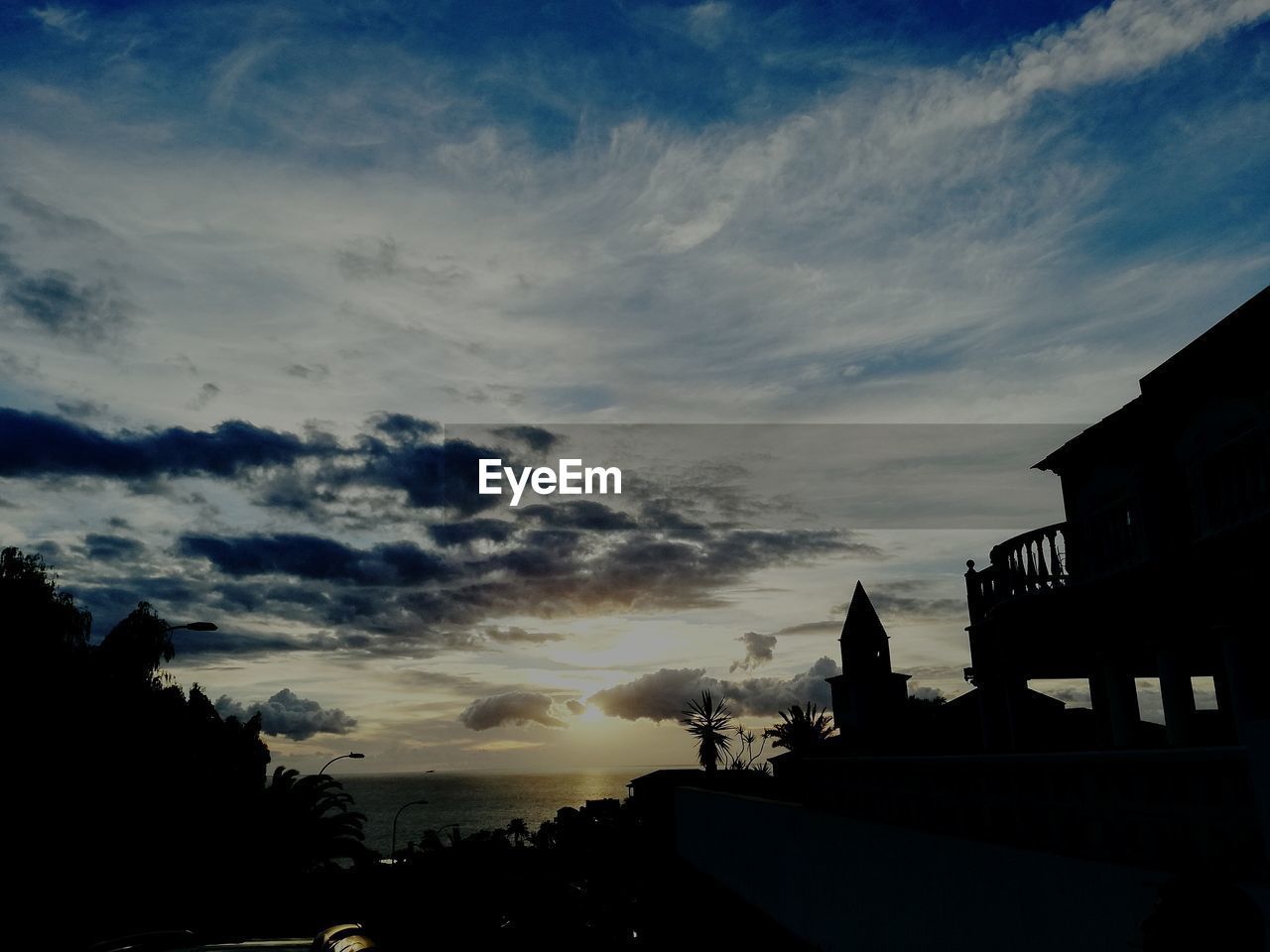 sky, built structure, sunset, silhouette, cloud - sky, building exterior, architecture, no people, outdoors, nature, tree, beauty in nature, city, day