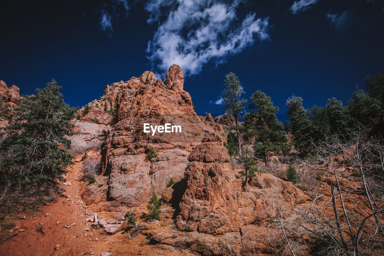 sky, rock, plant, rock - object, tree, beauty in nature, solid, nature, tranquility, tranquil scene, rock formation, no people, scenics - nature, cloud - sky, low angle view, land, non-urban scene, mountain, day, environment, outdoors, arid climate, climate, eroded