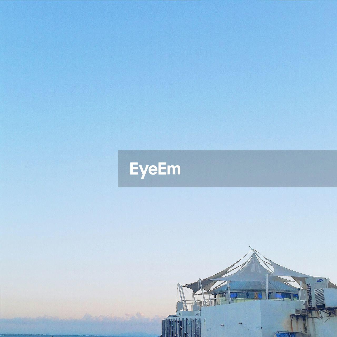 Ibiza beach club against clear blue sky