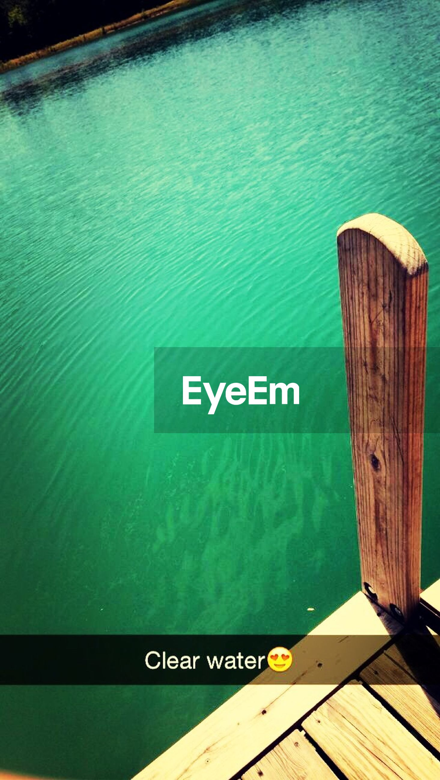 water, wood - material, blue, lake, high angle view, rippled, wooden, wood, swimming pool, pier, plank, reflection, communication, outdoors, no people, nature, text, day, tranquility, river