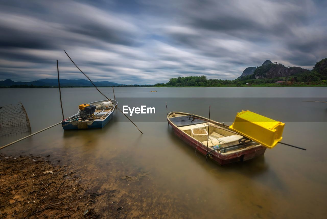water, nautical vessel, cloud - sky, transportation, sky, mode of transportation, nature, beauty in nature, scenics - nature, tranquility, waterfront, lake, day, tranquil scene, non-urban scene, outdoors, moored, no people, fishing boat