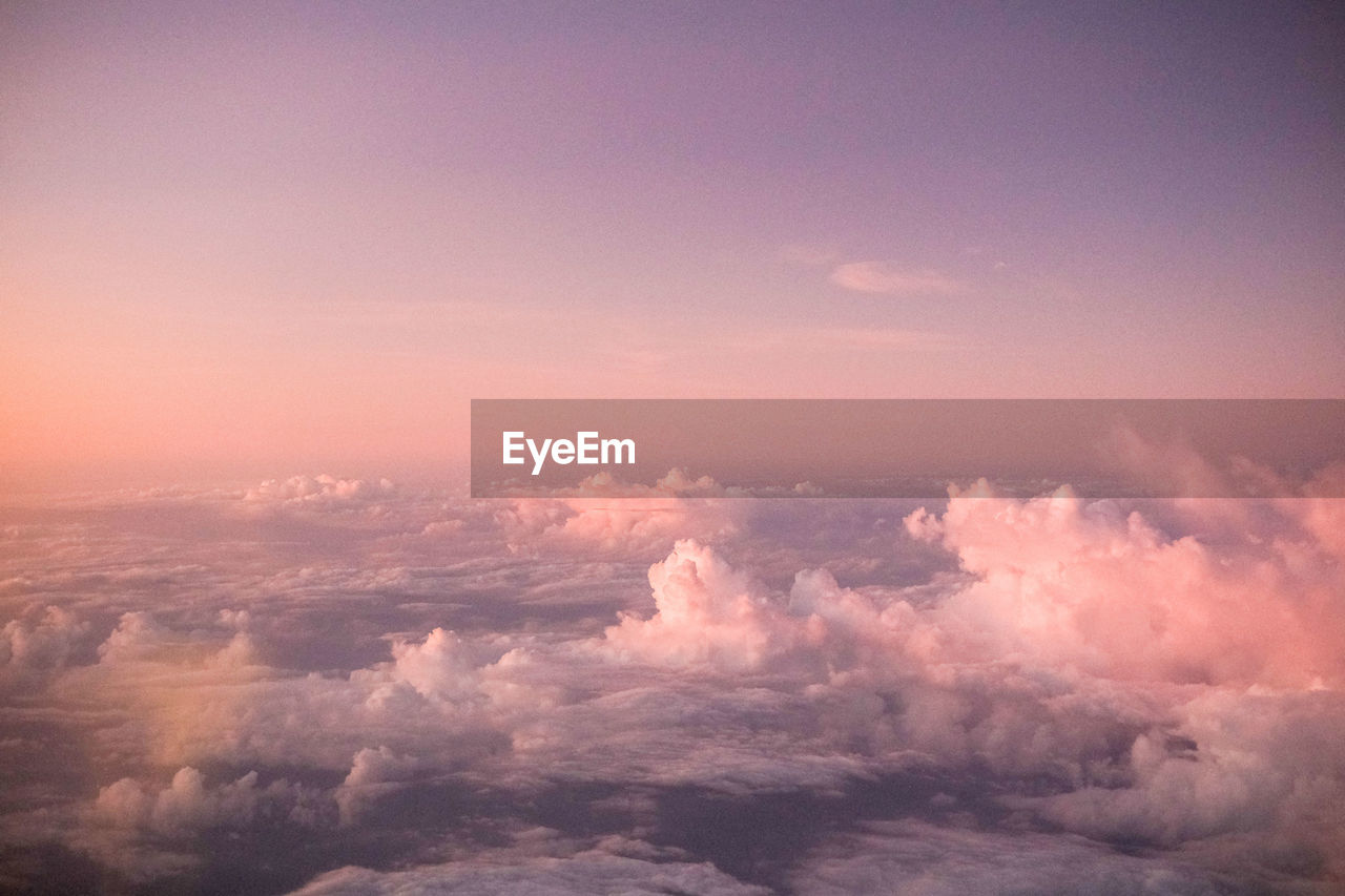 sky, beauty in nature, cloud - sky, tranquil scene, tranquility, scenics - nature, nature, idyllic, no people, sunset, outdoors, backgrounds, cloudscape, day, environment, dramatic sky, heaven, copy space, majestic, meteorology, wispy