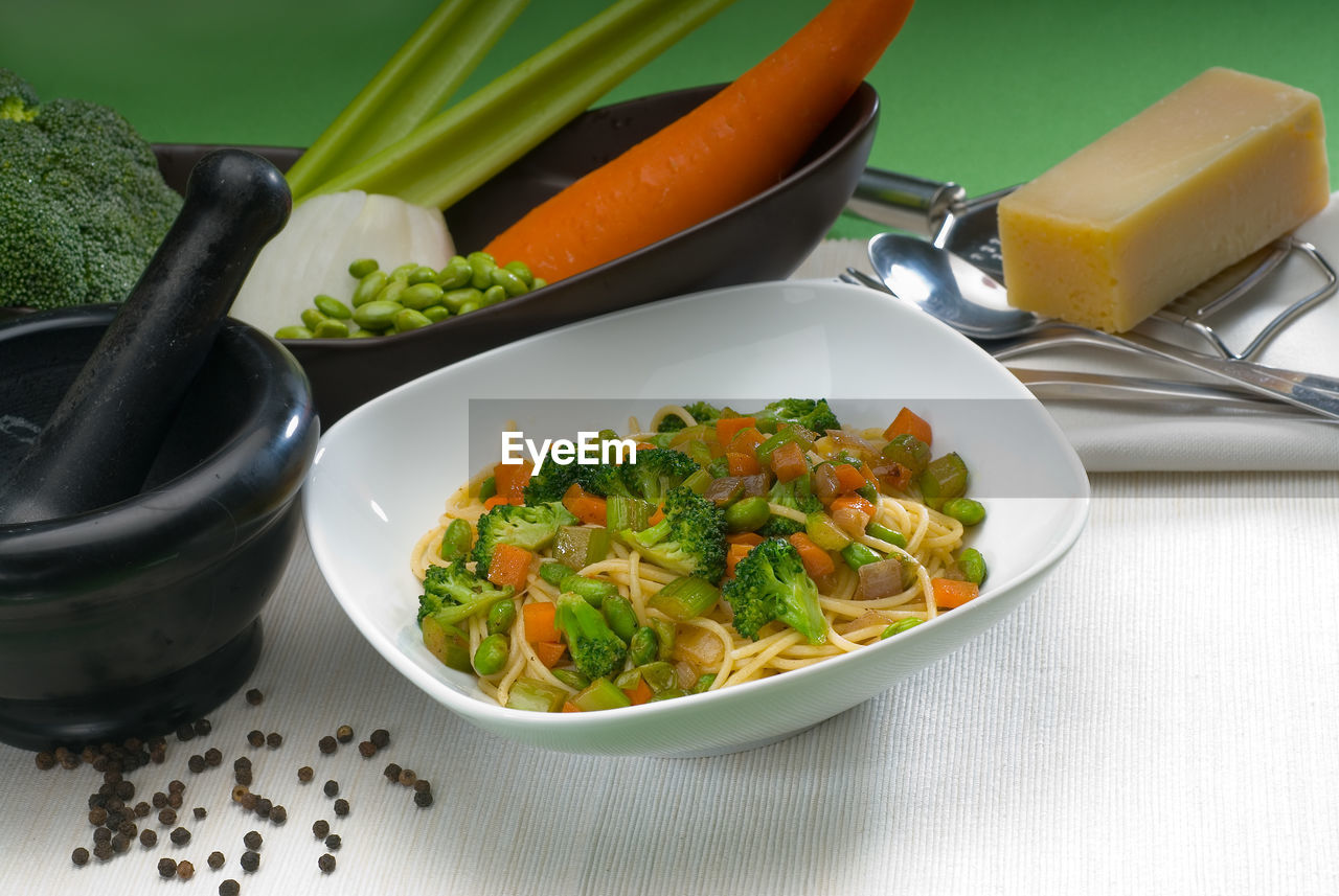 High Angle View Of Noodles With Vegetables Served On Table