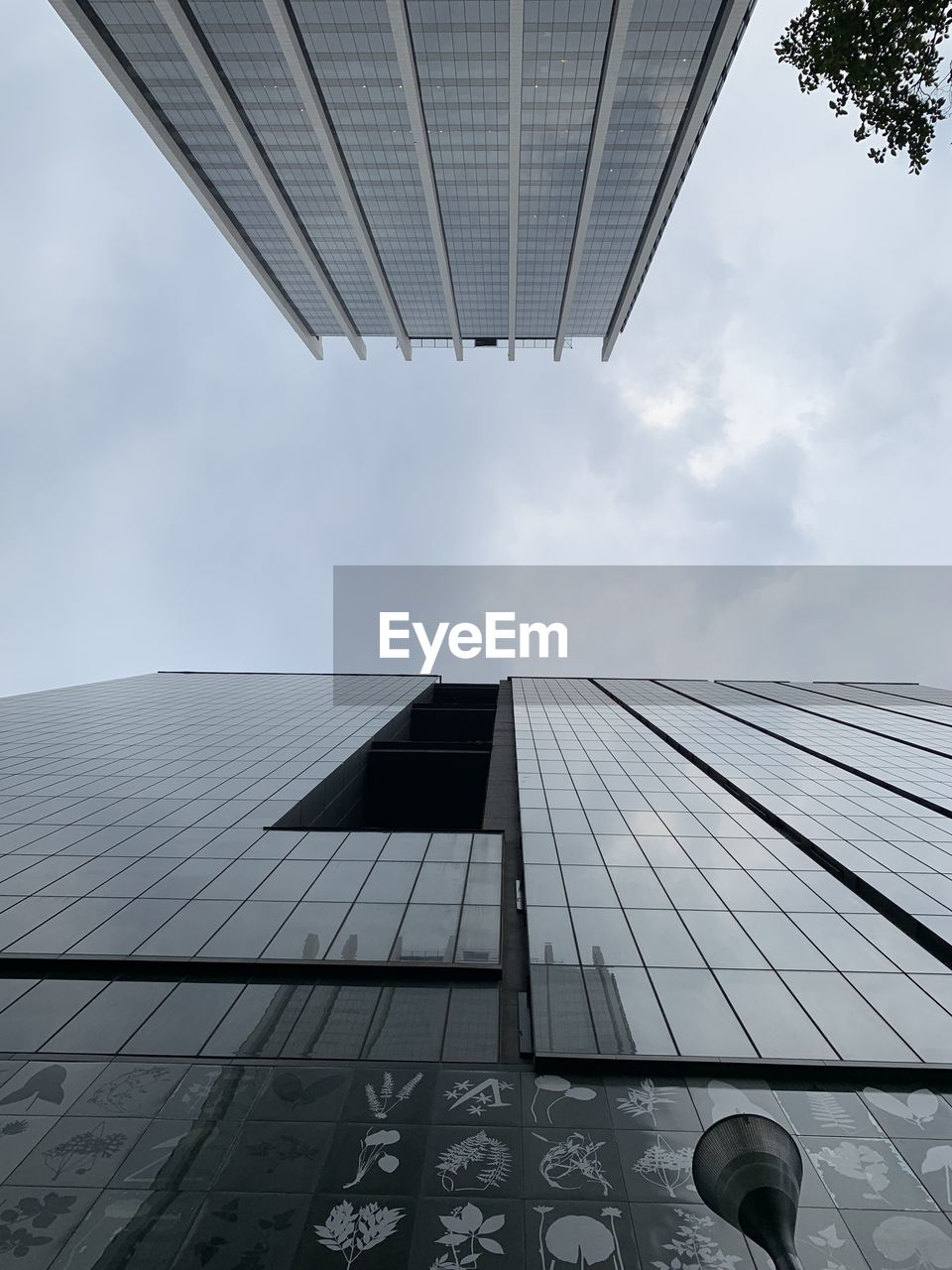 built structure, architecture, building exterior, sky, cloud - sky, building, low angle view, office building exterior, reflection, office, glass - material, tall - high, day, city, modern, nature, skyscraper, no people, tower, directly below, outdoors, glass, financial district