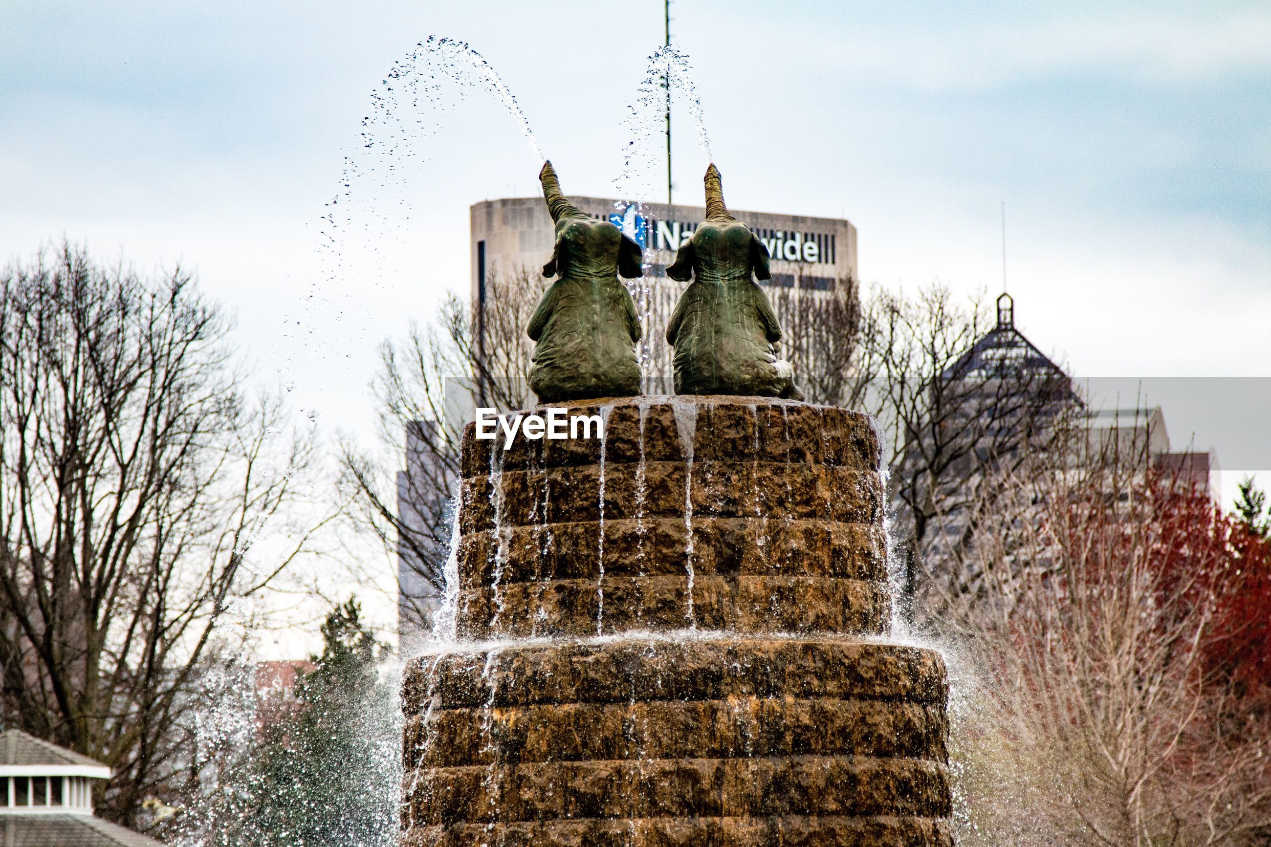 building exterior, built structure, architecture, low angle view, sky, fountain, tree, water, day, sculpture, statue, motion, steps, outdoors, art and craft, travel destinations, famous place, incidental people, travel