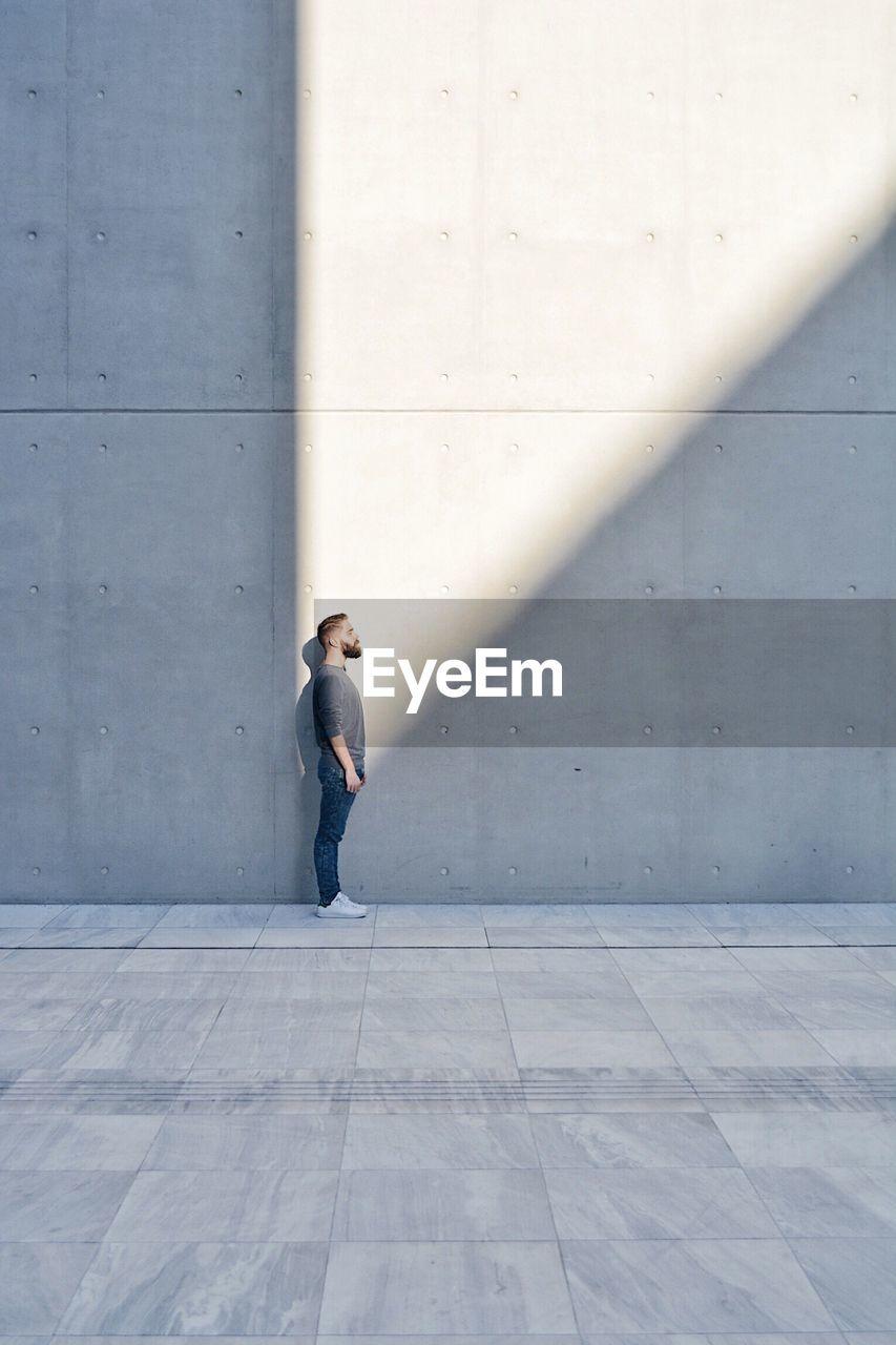 Full Length Of Man Against Wall