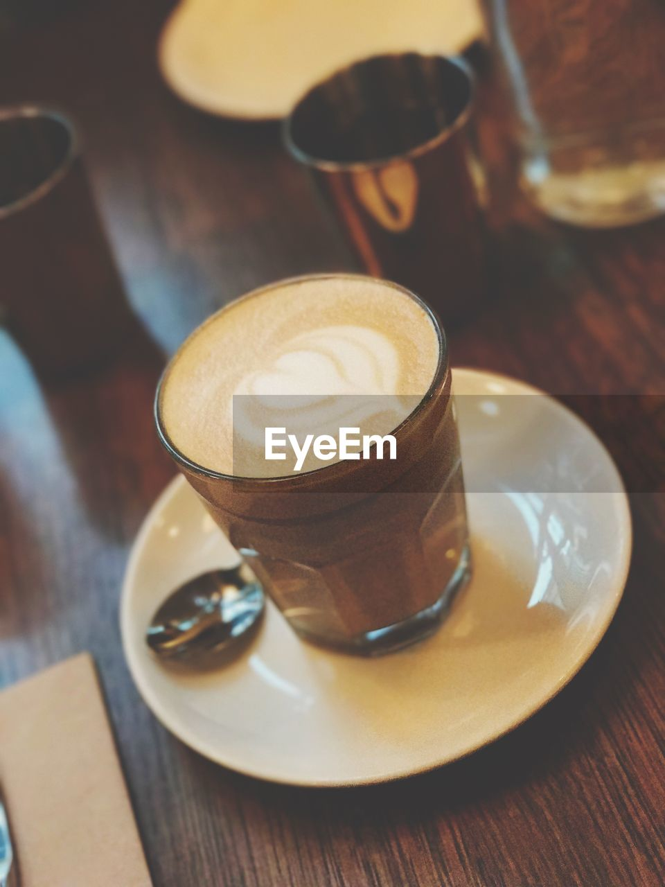 drink, coffee - drink, refreshment, coffee cup, table, food and drink, frothy drink, saucer, cappuccino, latte, indoors, froth art, no people, close-up, cafe, freshness, drinking glass, mocha, day
