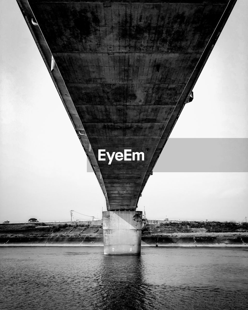 bridge - man made structure, connection, transportation, architecture, engineering, river, below, built structure, bridge, underneath, water, outdoors, day, no people, waterfront, low angle view, road, sky, under, nature