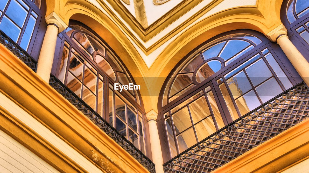 architecture, built structure, low angle view, building exterior, arch, no people, building, window, yellow, design, the past, pattern, history, day, gold colored, city, ceiling, sunlight, travel destinations, ornate, modern