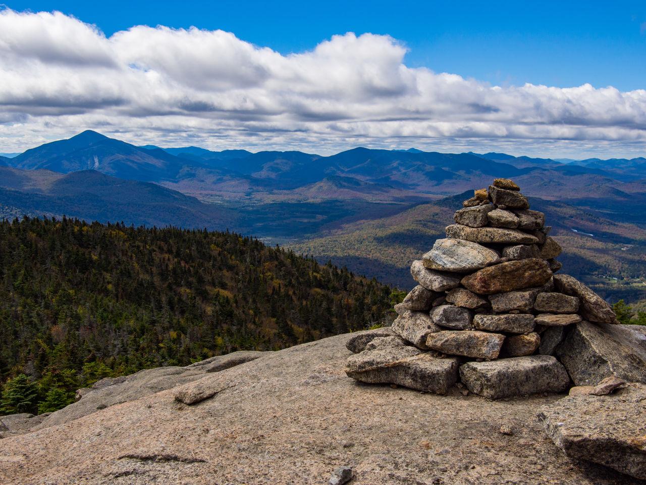 STACK OF ROCKS AGAINST MOUNTAIN RANGE