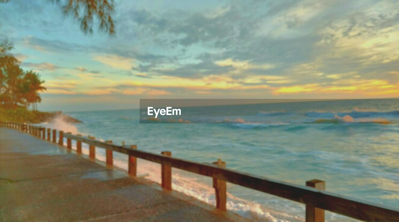 sea, water, nature, sunset, railing, scenics, sky, beauty in nature, tranquil scene, horizon over water, tranquility, outdoors, no people, beach, day