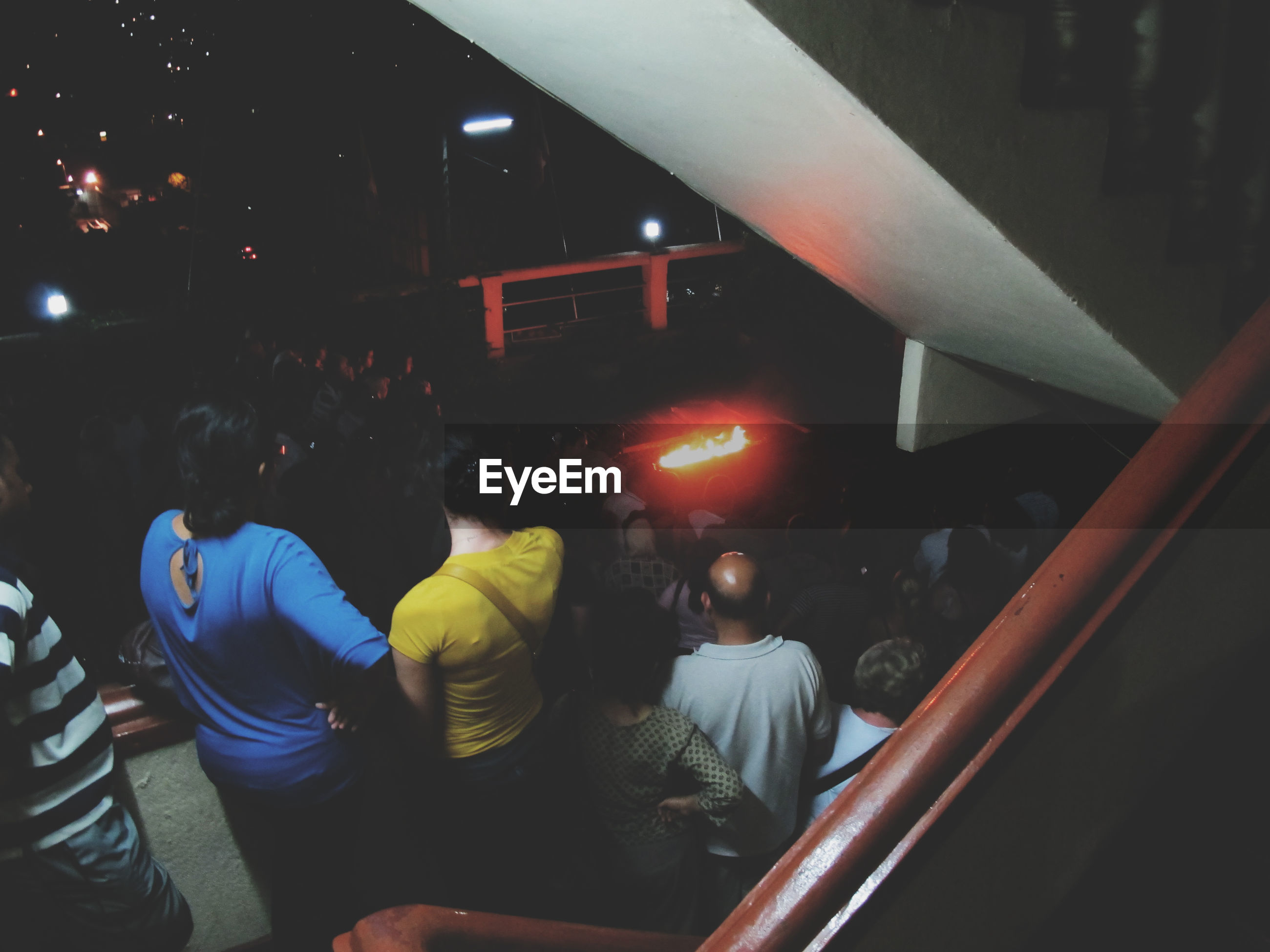 Elevated view of people watching performance