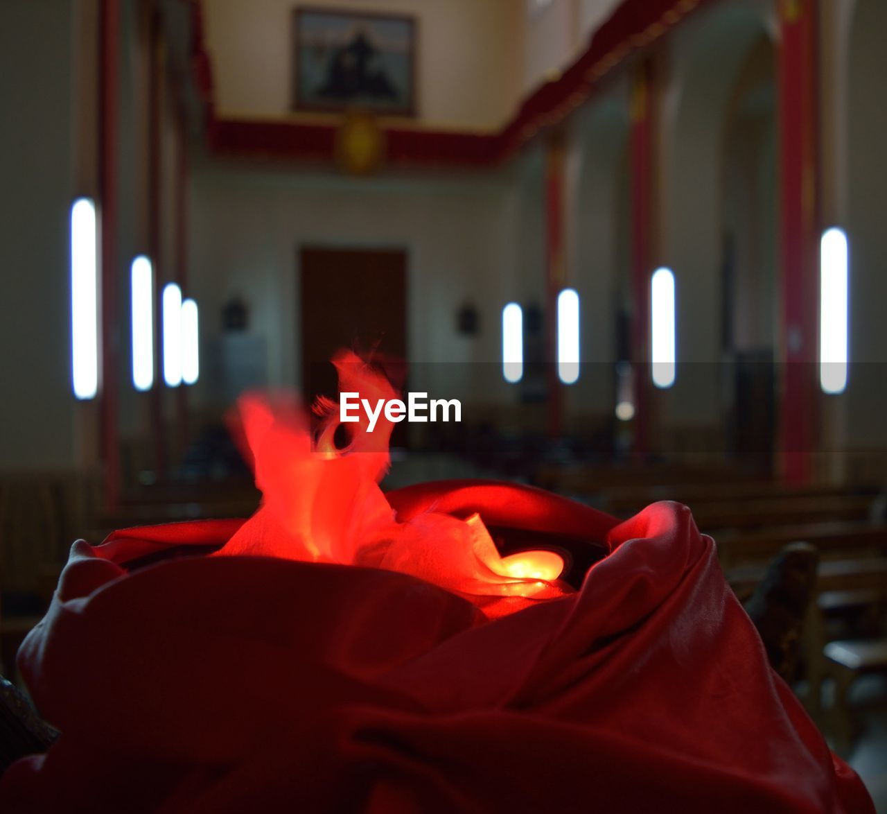 Illuminated lighting equipment amidst fabric in church