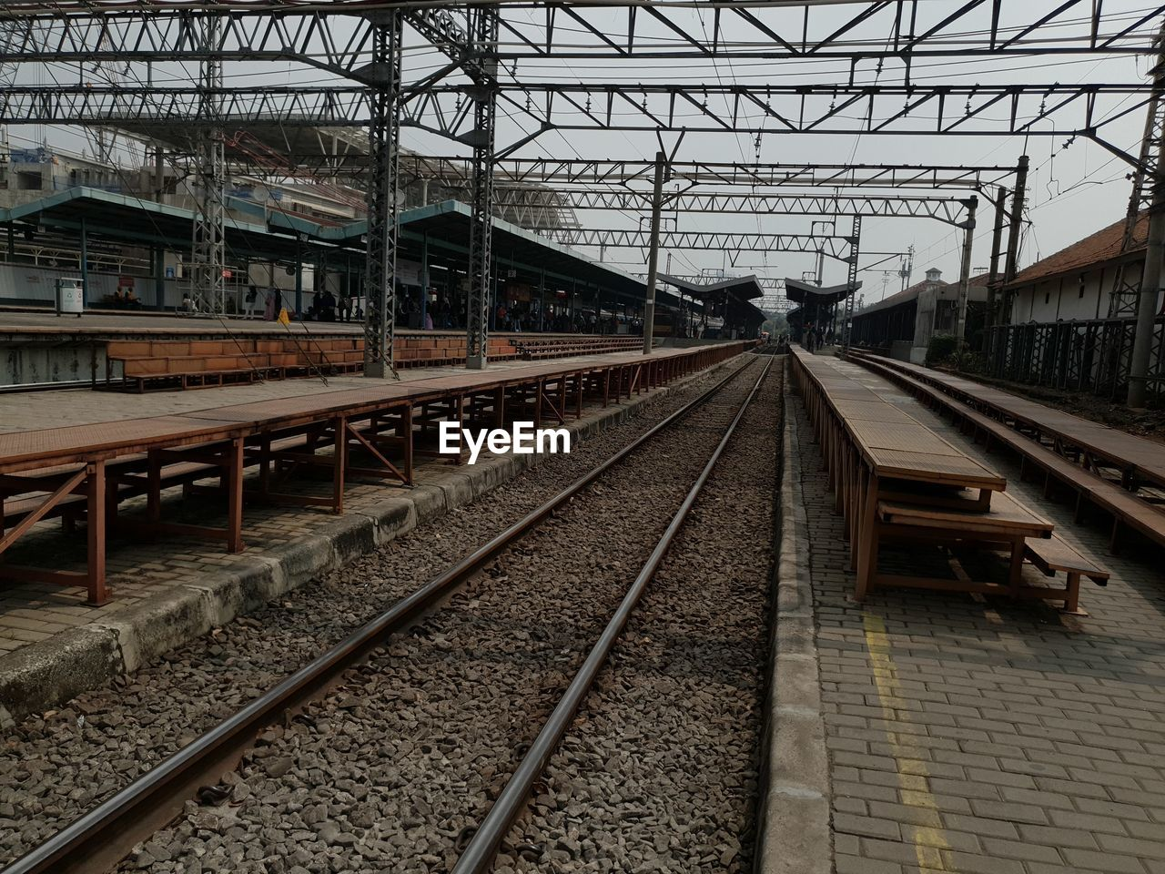 railroad track, track, rail transportation, transportation, public transportation, railroad station, built structure, mode of transportation, architecture, railroad station platform, no people, day, outdoors, nature, direction, travel, electricity, building exterior, metal, the way forward, shunting yard, station, power supply