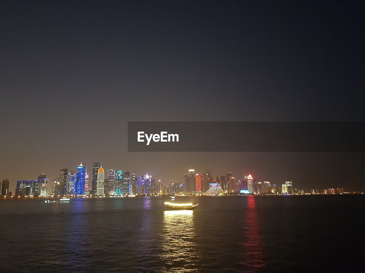 architecture, building exterior, night, built structure, waterfront, illuminated, water, sky, city, building, urban skyline, office building exterior, landscape, skyscraper, cityscape, no people, nature, sea, tall - high, outdoors, modern, light, financial district