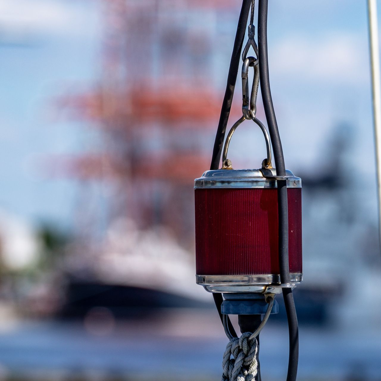 focus on foreground, day, metal, close-up, red, no people, hanging, outdoors, lighting equipment, transportation, mode of transportation, land vehicle, nature, bicycle, glass - material, sunlight, shape, selective focus, railing, bell