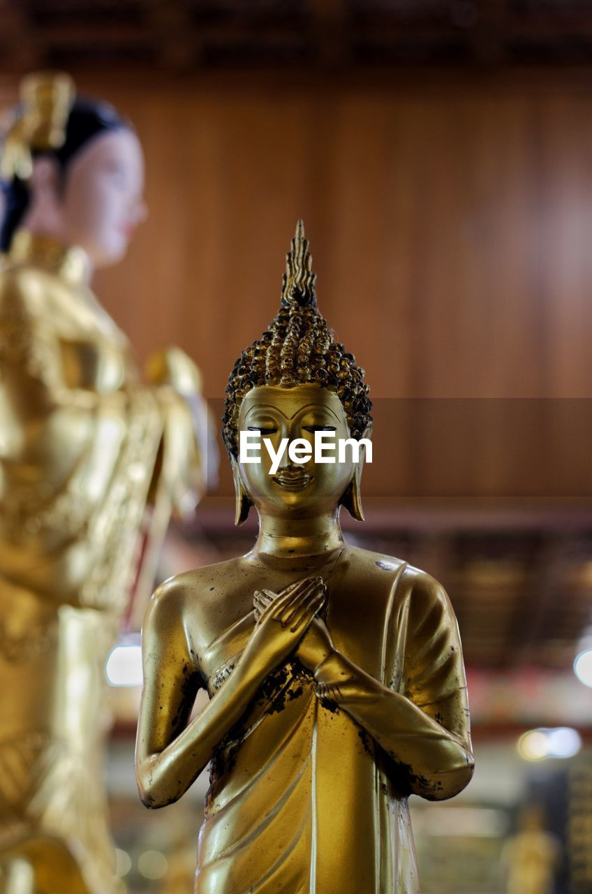 sculpture, human representation, statue, representation, belief, religion, spirituality, male likeness, art and craft, gold colored, place of worship, creativity, no people, indoors, idol, building, focus on foreground