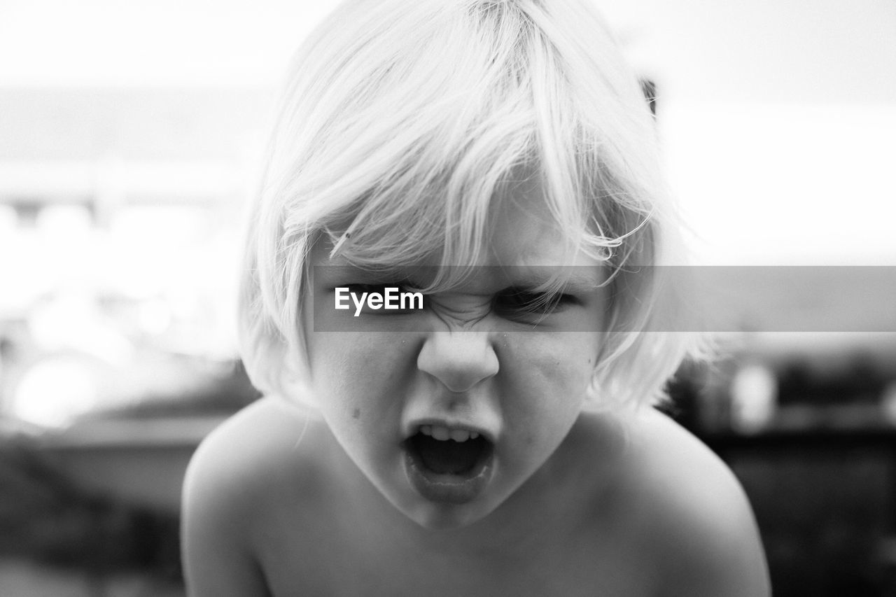 childhood, child, headshot, portrait, one person, real people, front view, focus on foreground, innocence, sadness, emotion, facial expression, close-up, cute, males, boys, shirtless, negative emotion, frustration, mouth open, making a face