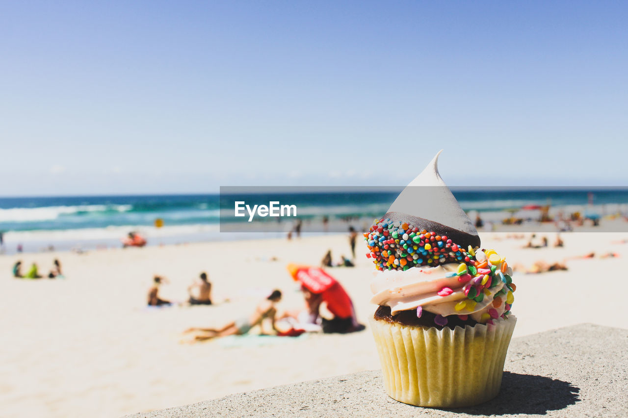 Close-Up Of Cupcake On Sunny Beach