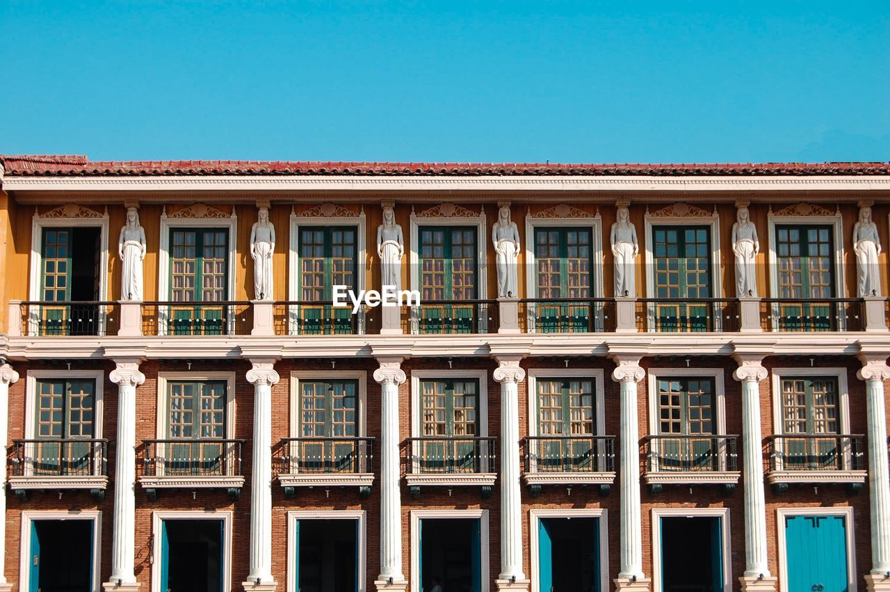 building exterior, built structure, architecture, window, no people, sky, day, nature, city, building, clear sky, blue, outdoors, side by side, in a row, reflection, copy space, the past, history, low angle view