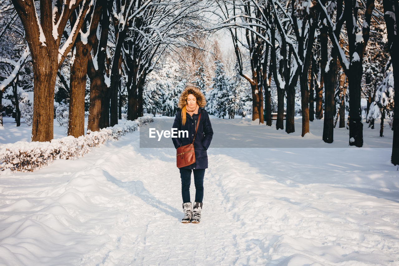 Full Length Of Woman Standing On Snow