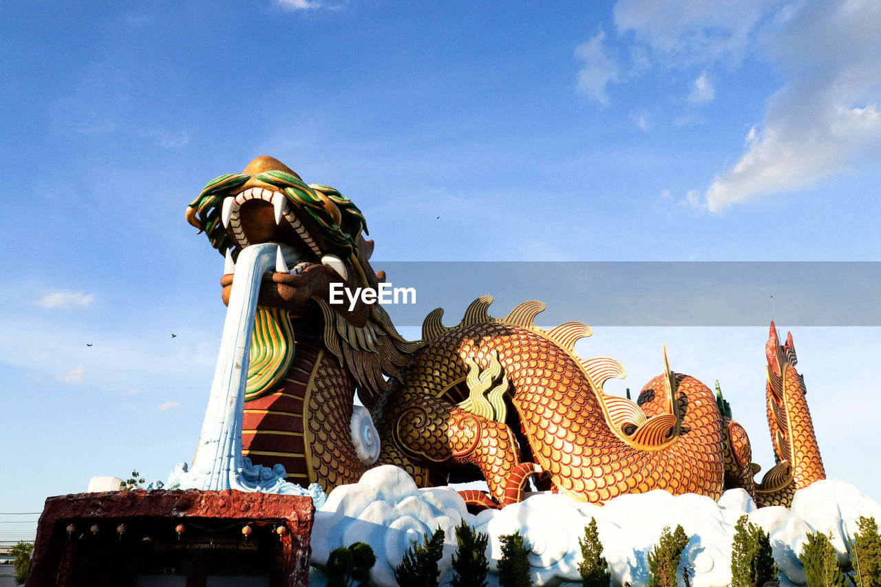 sculpture, representation, statue, sky, art and craft, low angle view, human representation, creativity, day, architecture, no people, nature, cloud - sky, belief, religion, built structure, spirituality, craft, outdoors
